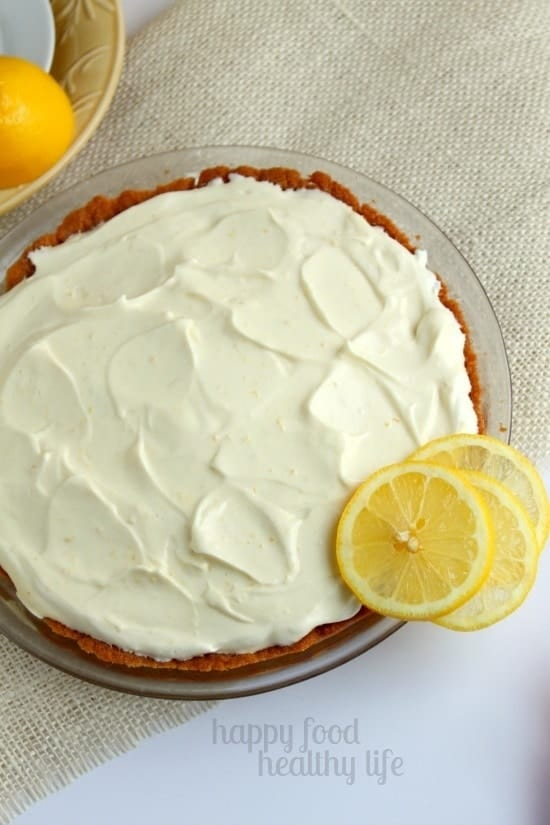Lemon Chiffon Pie - This light, fluffy, and sunshine-y dessert is bound to bring warmth to your life. www.happyfoodhealthylife.com