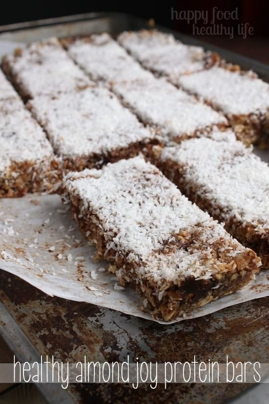 Healthy Almond Joy Protein Bars - Your favorite candy bar flavors, wrapped up in a bar that's full of nutrients. Now that's a win! www.happyfoodhealthylife.com #healthy #protein #snack