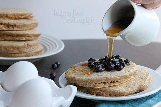 Healthy Whole Wheat Pancakes. If you're looking to try and make your mornings healthy, these deliciously fluffy pancakes are where you should start! www.happyfoodhealthylife.com #healthy #pancakes #breakfast