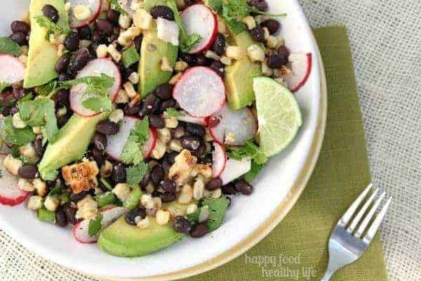 Grilled Black Bean & Corn Salad. The perfect way to enjoy your favorite grilled flavor while keeping to your health goals. www.happyfoodhealthylife.com #grill #salad #healthy