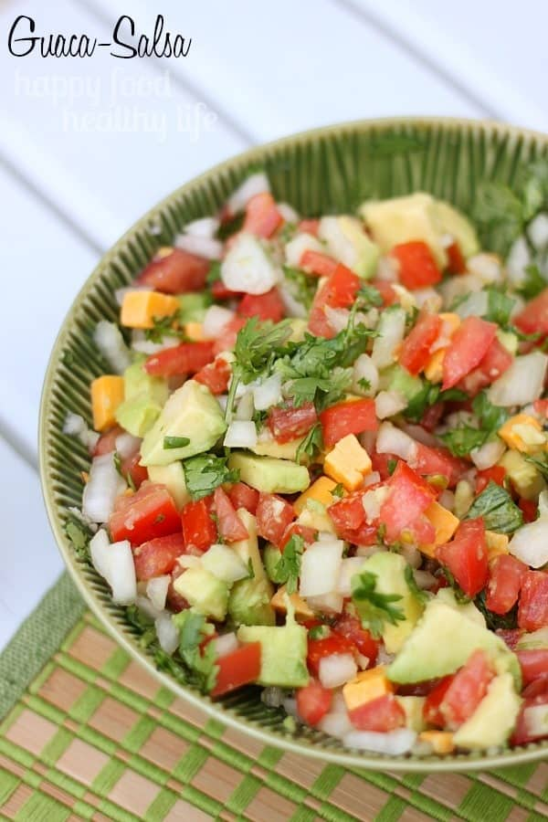 Guaca-Salsa - A delicious hybrid between salsa and guacamole. Perfect to top on your burgers, your tacos, or just right onto a spoon and into your mouth! www.happyfoodhealthylife.com