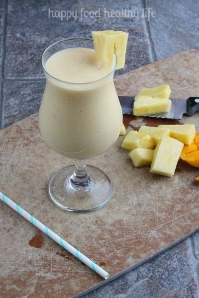 Tropical Pineapple Juice - Getting all your fruits in during the day can be rough. But with this juice, you can get all your servings in one glass!   www.happyfoodhealthylife.com