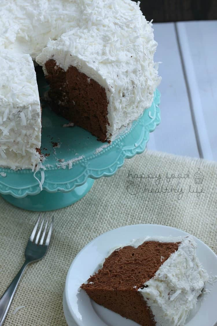 Chocolate Angel Food Cake topped with Whipped Coconut Frosting - light and fluffy and perfect for any celebration | www.happyfoodhealthylife.com