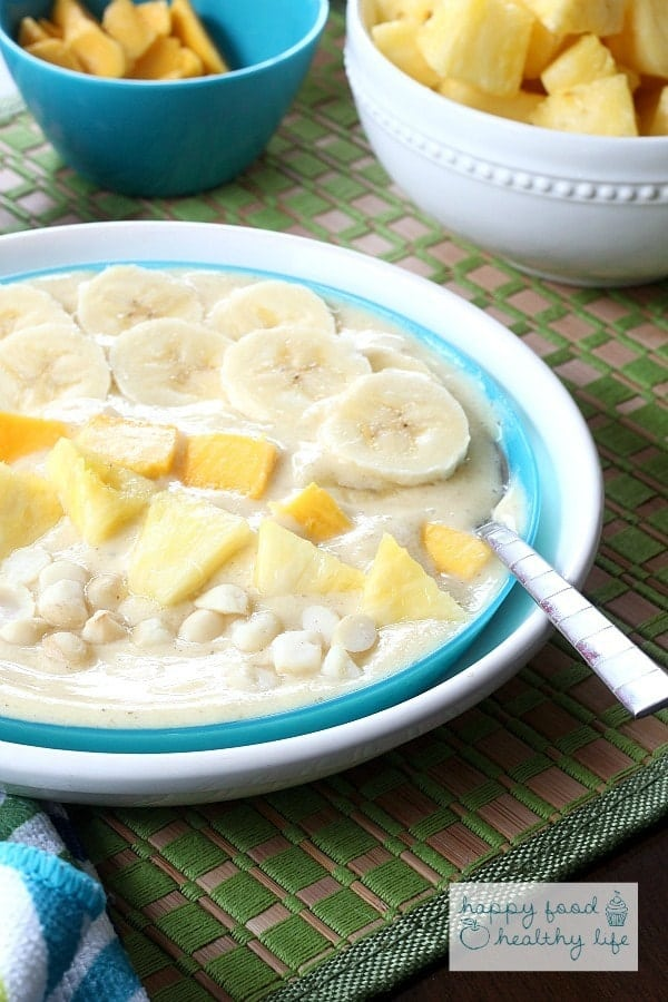 Tropical Smoothie Bowl - Sometimes you just don't feel like drinking your meals. Put together this bowl full of healthy sunshine for your next breakfast!   www.happyfoodhealthylife.com