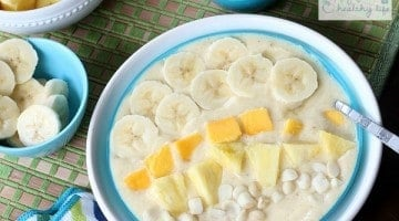 Tropical Smoothie Bowl - Sometimes you just don't feel like drinking your meals. Put together this bowl full of healthy sunshine for your next breakfast! | www.happyfoodhealthylife.com
