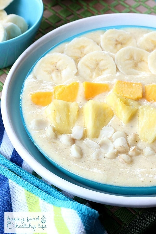 Tropical Smoothie Bowl - Sometimes you just don't feel like drinking your meals. Put together this bowl full of healthy sunshine for your next breakfast or healthy snack! | www.happyfoodhealthylife.com
