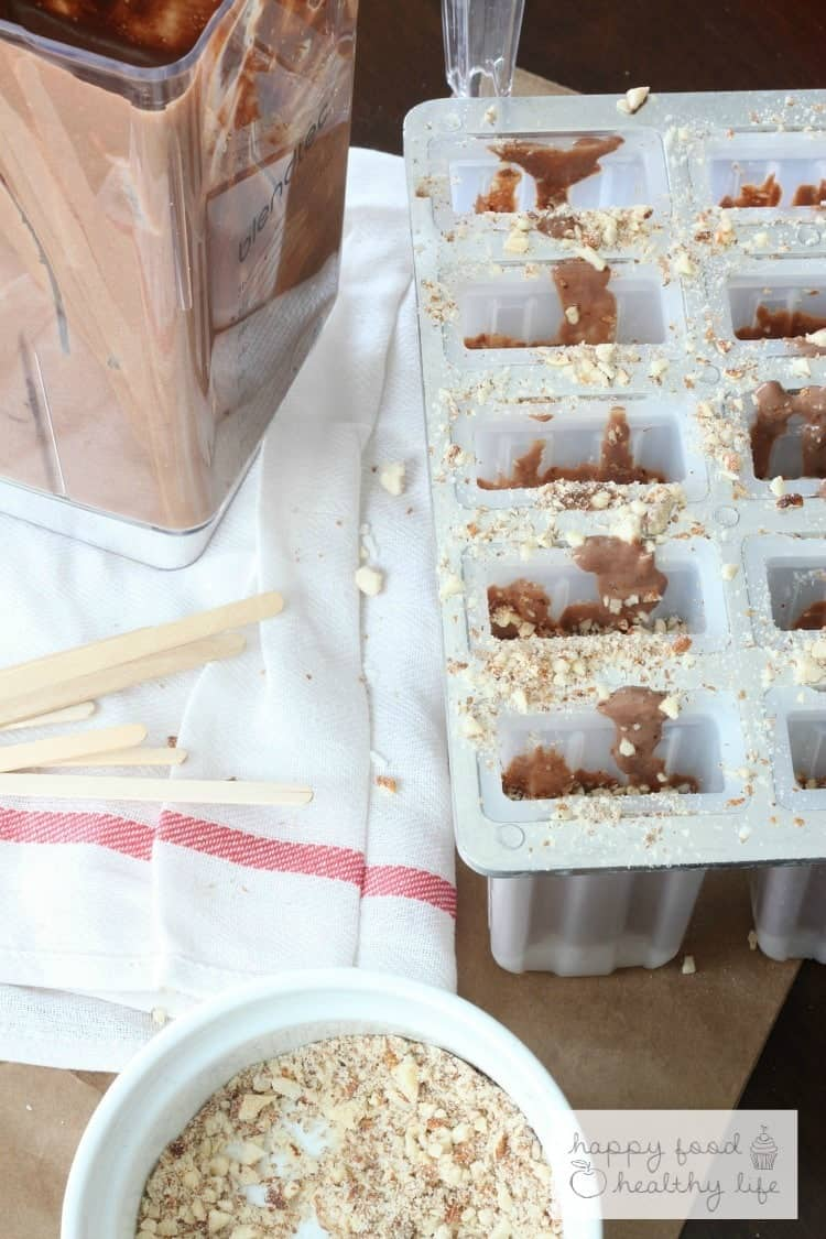Vegan Coconut Almond Fudgsicles - These come together in less than 5 minutes with your blender, and you'll never know that you're getting more protein and that they are vegan!!   www.happyfoodhealthylife.com