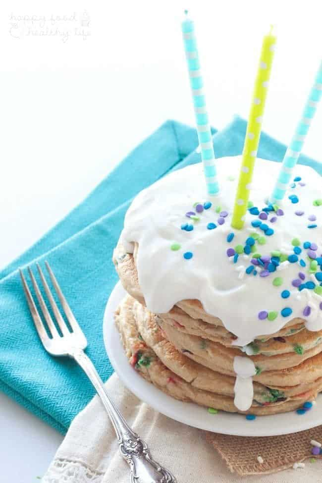 Lightened Up Birthday Cake Pancakes - Celebrate a birthday in style with a stack of health-conscious pancakes topped with a healthy yogurt and sprinkles! | www.happyfoodhealthylife.com