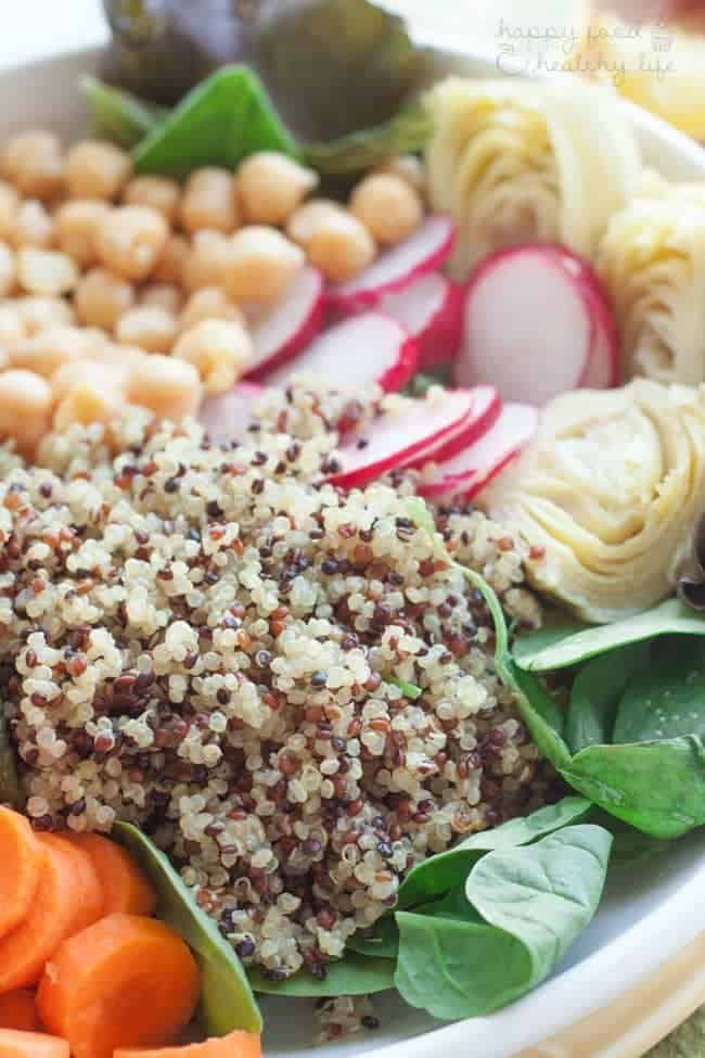 "Tri-Color Quinoa Salad - This healthy vegetarian salad is full of cleansing vegetables that help you ""reset"" when you need lots of nutrients 