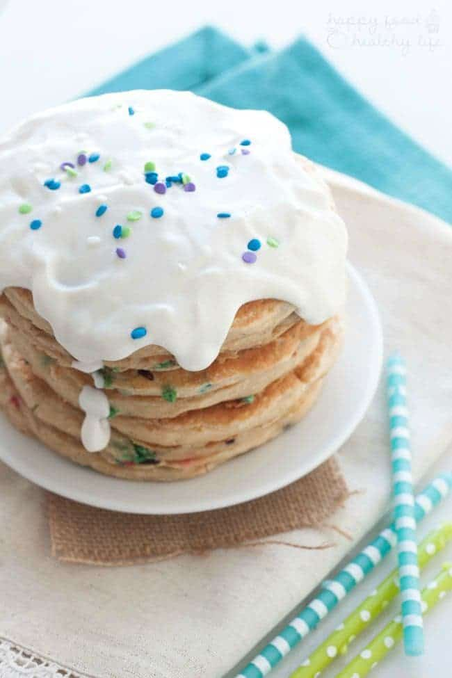 Lightened Up Birthday Cake Pancakes - Love celebrating birthdays with an awesome over-the-top breakfast but would like to do it in a healthy manner? These birthday cake pancakes are a total win! | www.happyfoodhealthylife.com