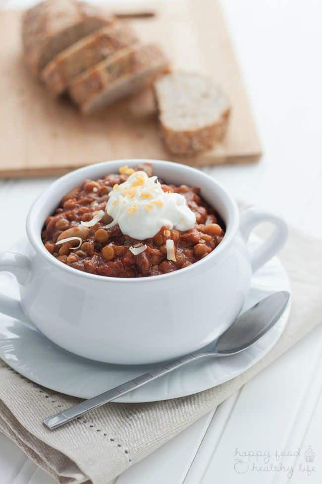 Slow-Cooker Vegetarian Chili - This Crock Pot Recipe is one of the best Vegetarian Chili recipes I've ever made. It takes just 5 minutes to throw everything in together. Set it and forget it! 5 hours later, and you have a hearty and healthy recipe that is sure to warm you from the inside!