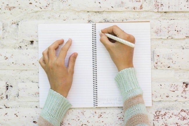 Girl writes in notebook