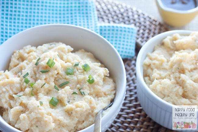 Healthy Herb & Garlic Mashed Cauliflower - A healthy alternative to mashed potatoes that will please everyone! Full of flavor. Healthy. And no one will even know the difference. Really!