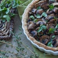 This Mushroom Spinach Tart is the perfect way to include a meatless dish at your next dinner. With a whole wheat crust and warm cheese, this tart is all comfort food!