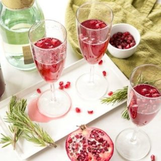 2-Ingredient Pomegranate Mimosas - the simplest cocktail to add holiday cheer to your party!