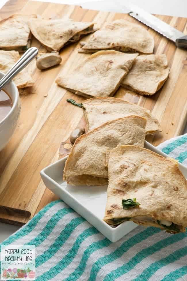 This Cheesy Vegetarian Spinach & Mushroom Quesadilla Recipe is one you can get on the table in minutes for an easy and healthy dinner that your whole family will love. Pair it with a hot bowl of soup, and you'll be the hero of dinner!
