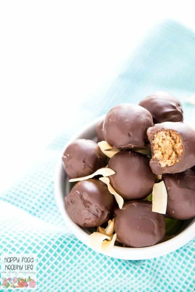 Healthy Dark Chocolate-Dipped Almond Butter Coconut Haystacks - If you love Almond Joy candy bars and can't get enough of the chocolate-coconut combo, you have GOT to give these a try! They're actually healthy and come together in no time at all. Click through for one of the best recipes you'll ever make! You won't be sorry.