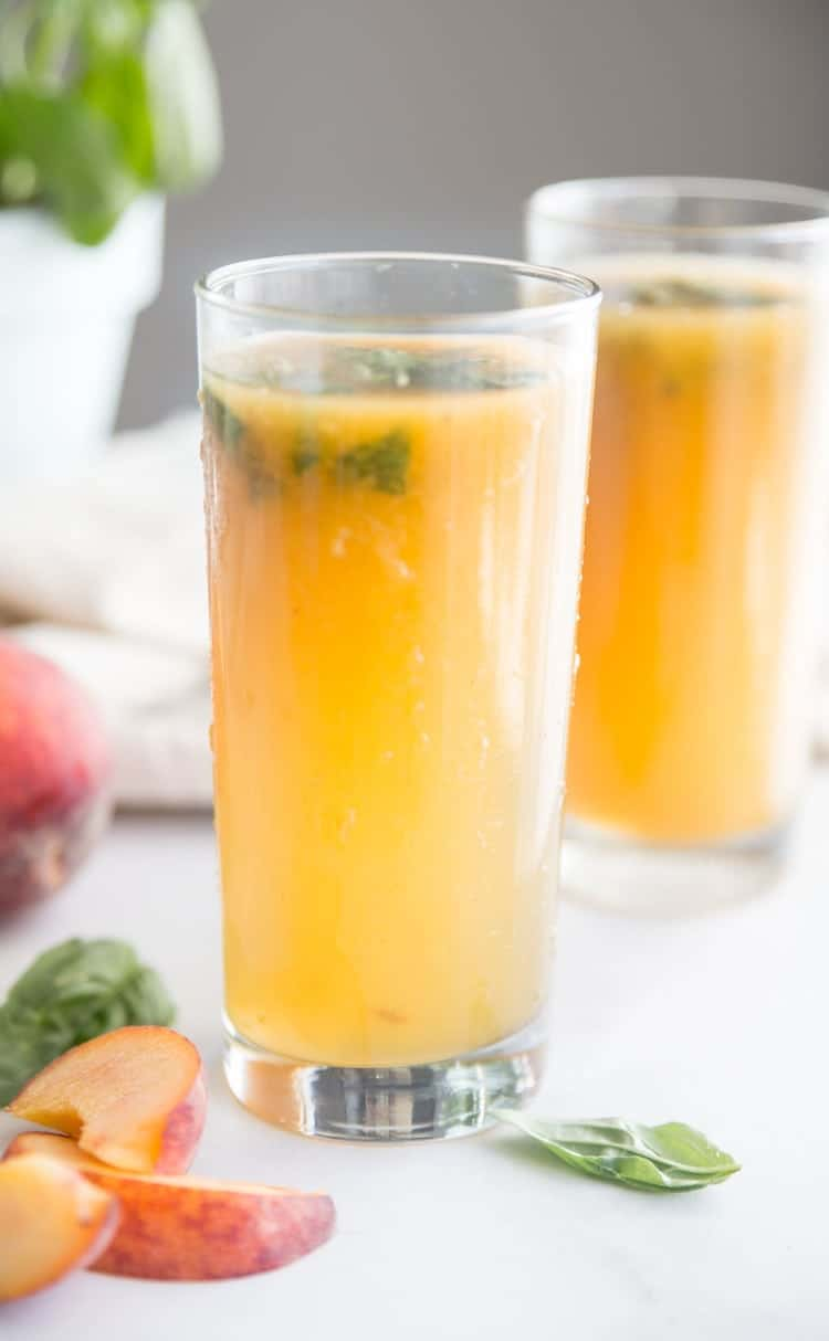 Find out how to make a Peach Basil Whiskey Cocktail right from your own DIY Herb Garden. Talk about refreshing for the warm months of summer!