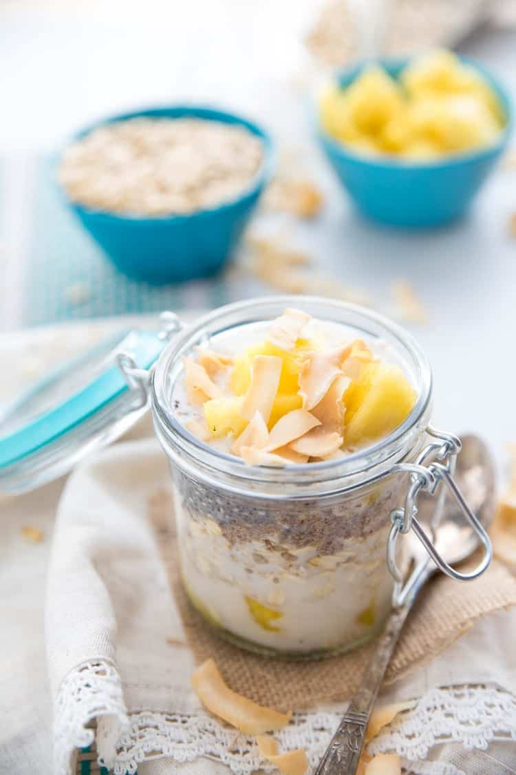 Amp up your summer mornings with these Dairy-Free Pina Colada Overnight Oats. Fresh summer flavor that will take you right to your favorite sandy beach. There is no need to heat up the kitchen even more with a refreshing jar of healthy overnight oats. And of course, when it tastes like a pina colada, it's an all-around win. Click through to get the recipe - only 5 ingredients!