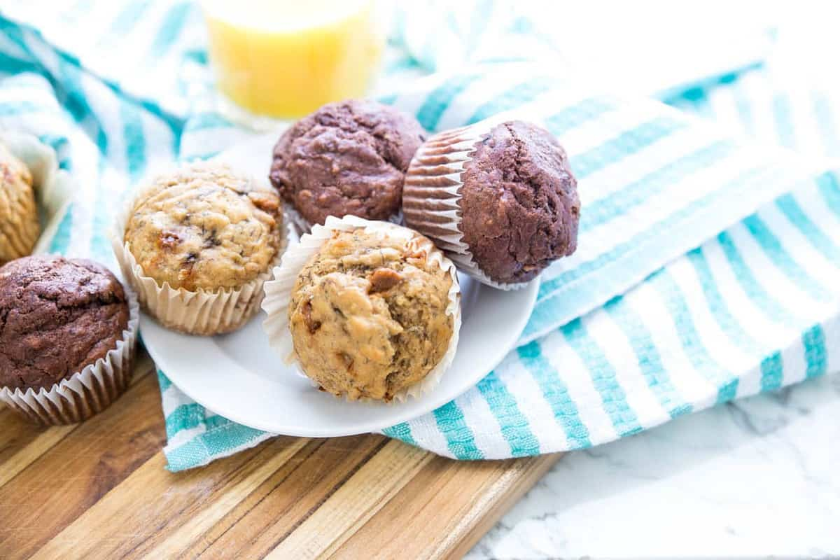 Know you want to make muffins but can't decide on a flavor? Or maybe one kid wants one flavor and another wants something else. With this recipe, you can divide and conquer and make everyone happy by making these Healthy Banana Bread Muffins two different ways! Click through to find out just how easy it is to please everyone!