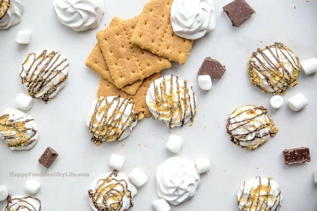 Vegan S'mores Meringues - This fun S'mores treat is perfect whether you're vegan, health-conscious, or just looking for a light and airy treat. They're made using a mysterious ingredient that does magical things in the kitchen. You do not want to miss this recipe!