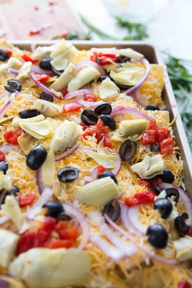 Mediterranean Nachos - an easy meat-free snack that's perfect for game day, after school, movie night, or just when you don't feel like cooking dinner.