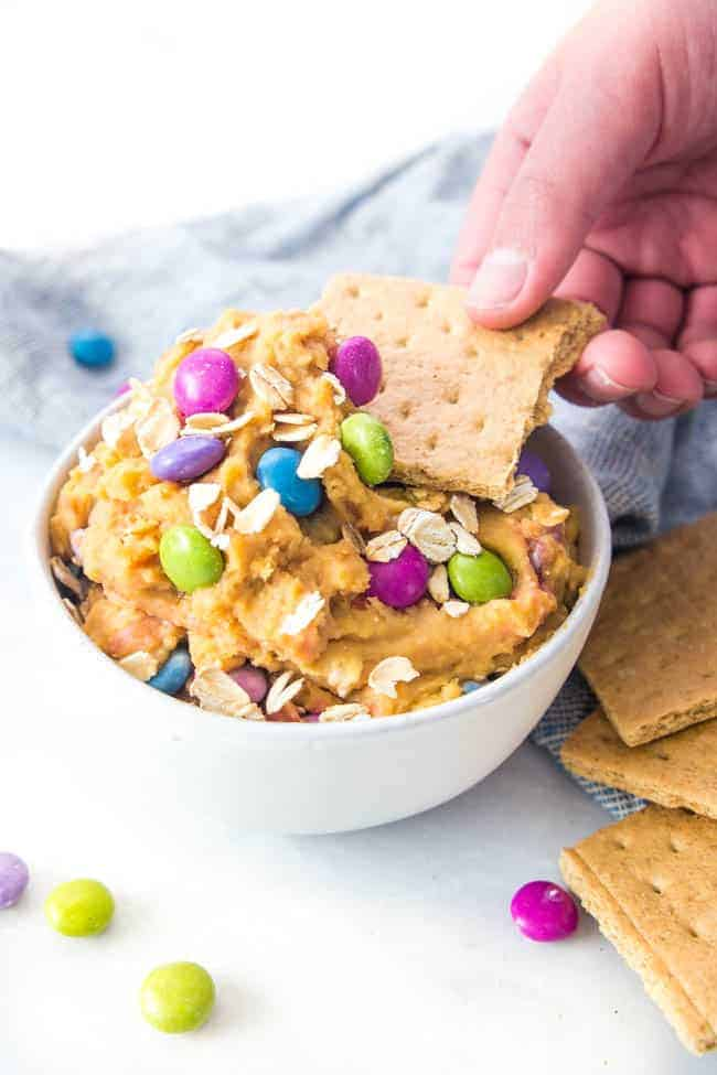 Monster Cookie Sweet Hummus - a healthy dessert hummus that will trick your sweet tooth into thinking you're eating a treat!
