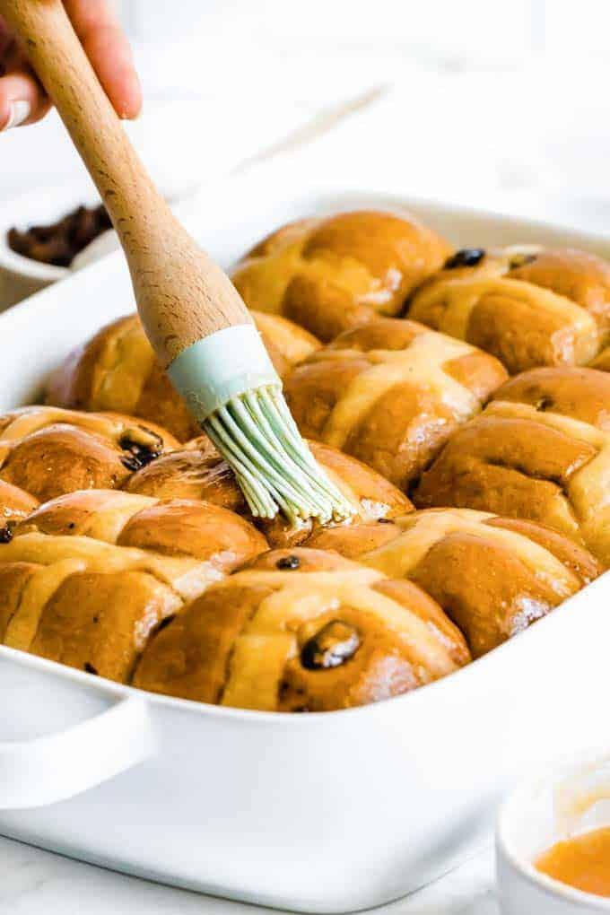 brushing on glaze for hot cross bun recipe
