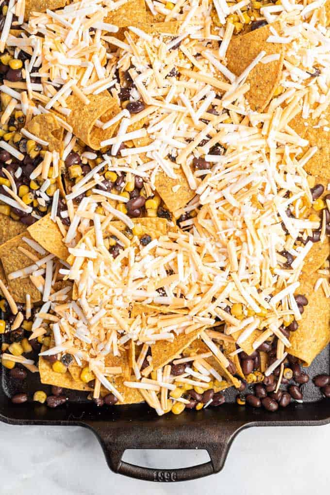 black beans, corn, and cheese on nachos