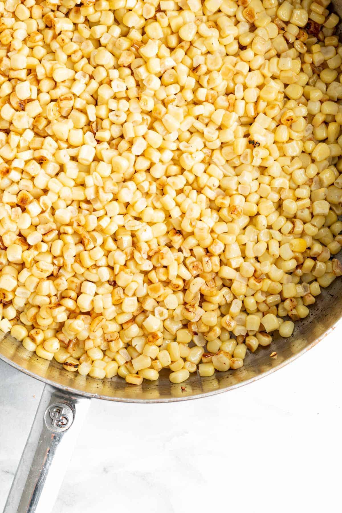 corn in skillet for street corn salad