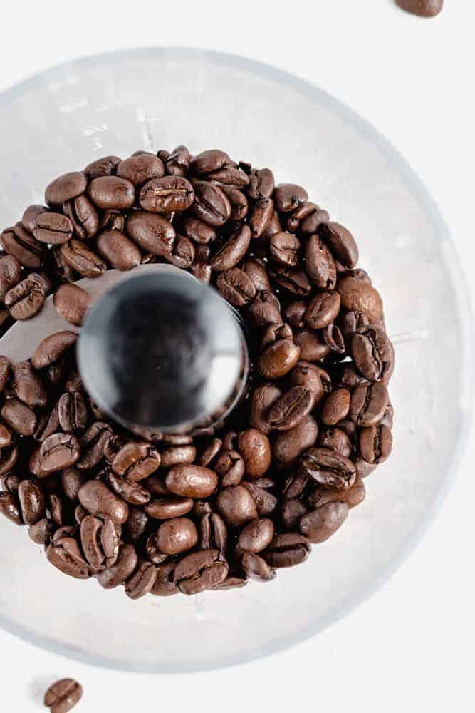 organic coffee beans in a coffee grinder