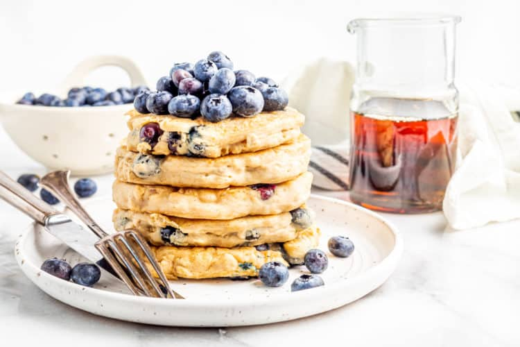 vegan blueberry pancakes - stacked up tall and ready to bite into