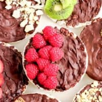 chocolate covered rice cakes topped with berries, nuts, and fruits