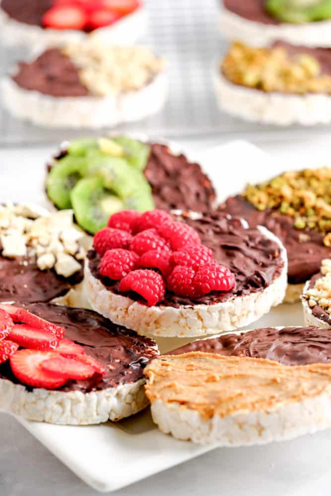 Rice Cakes with melted chocolate, fruit, and nuts