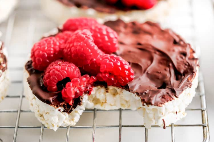chocolate covered rice cakes topped with fresh raspberries