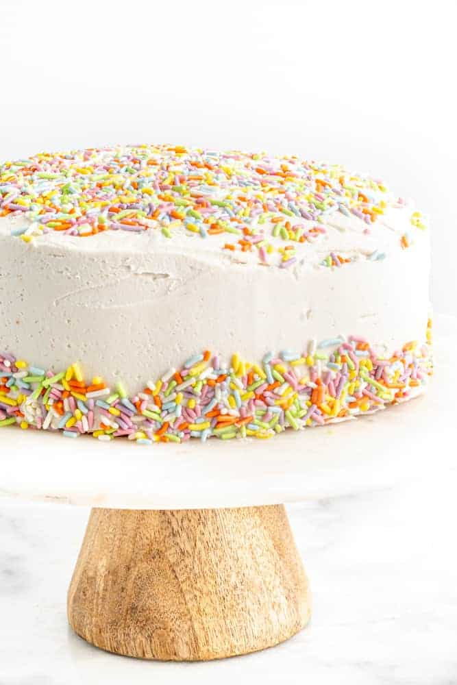 vegan birthday cake on cake stand