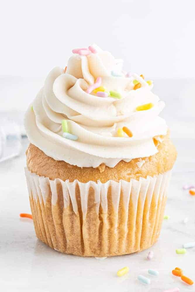 vegan buttercream piped on top of a cupcake