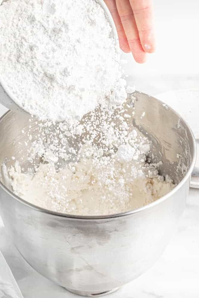 adding powdered sugar to whipped vegan butter